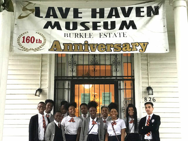 students standing in front of the Slave Haven Underground Railroad Museum for the 160th Anniversary